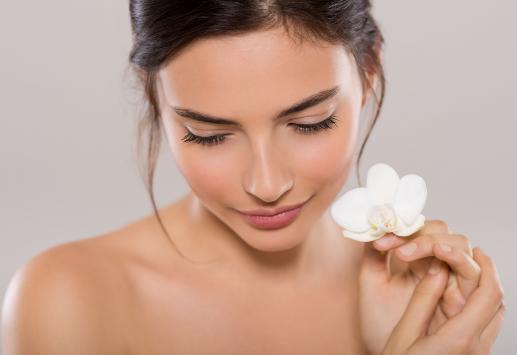 Women holding flower ready for feminine rejuvenation surgery