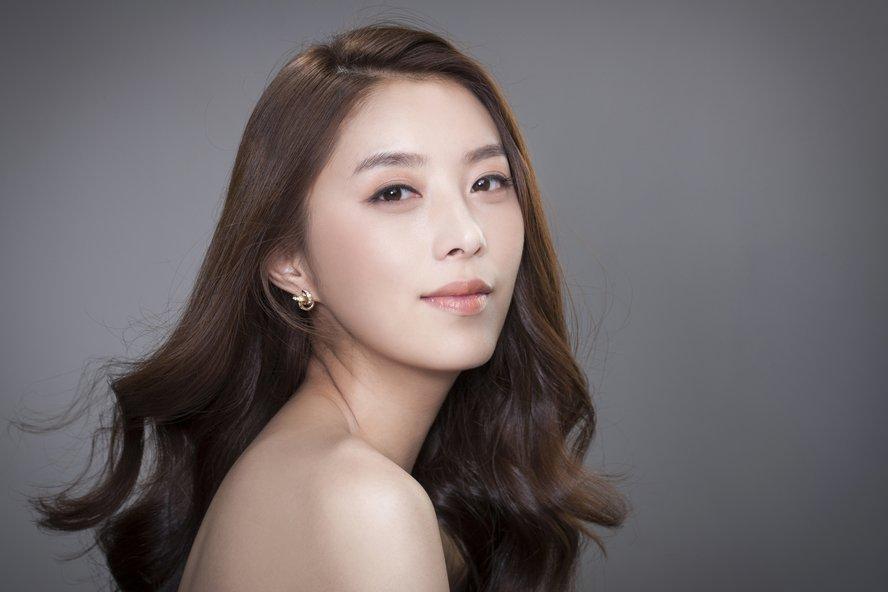 Beautiful asian girl with hair down looking at camera